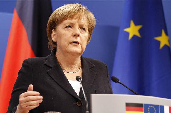 Меркель потребовала от Путина, чтобы ополченцы прекратили огонь