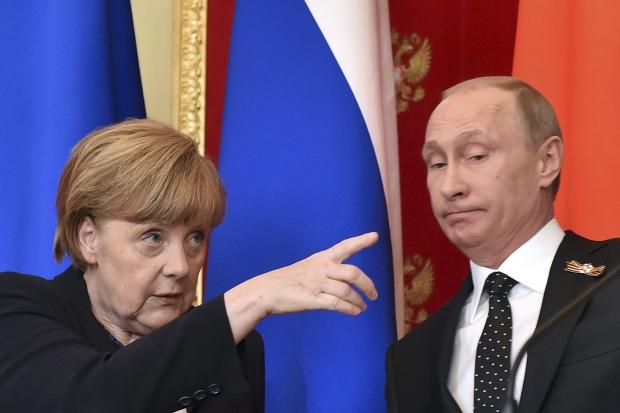 Путин и Меркель договорились о дальнейшей судьбе минского процесса