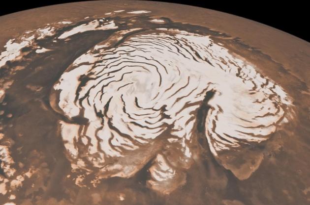 Зима на Марсе: специалисты NASA опубликовали завораживающие кадры заснеженной Красной планеты