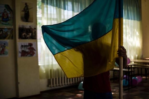 Что значит быть ребенком на войне? Журналисты из National Geographic опубликовали пронзительные кадры с Донбасса