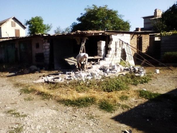Последствия обстрела поселка Красный Партизан