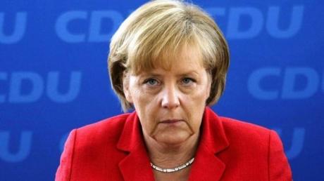 Меркель уверена в возможности установить мир в Донбассе