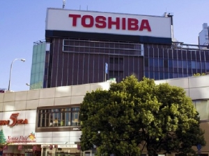 Toshiba, отставка, скандал