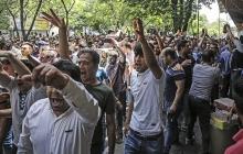 Иран на грани: почему страна охвачена массовыми беспорядками, и сможет ли Роухани избежать импичмента