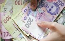 Курс валют в Украине: НБУ несколько ослабил курс гривны, а доллар и евро немного выросли на межбанке
