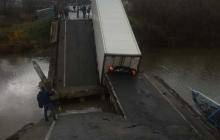 В России не выдержал и рухнул еще один мост вместе с фурой - есть жертвы: кадры