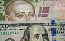 На межбанке курс доллара достиг очередного минимума