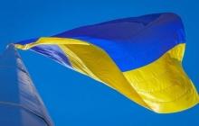 """Флаг Украины в """"ЛНР"""": заключенные противодействуют злодеяниям боевиков – кадры"""