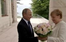 В Сочи начались переговоры Путина и Меркель, а Медведева на них не оставили - видео