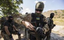 Война на Донбассе: бойцы ВСУ вынесли боевиков вперед ногами