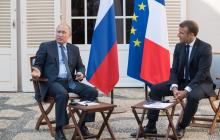 Макрон пристыдил Путина в Париже из-за протестов в Москве