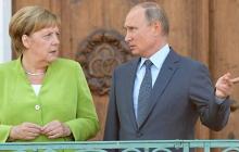 Меркель призвала Путина к встрече в нормандском формате: Путин выдвинул условия