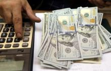 """Курс доллара на 24 декабря: """"зеленый"""" продолжает стремительно падать"""