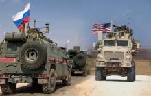 В Сирии военный БТР США пошел на таран российского патруля, скинув его в кювет, видео