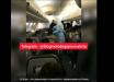 Первое видео с борта самолета из Китая: люди в спецодежде раздают коробки с неизвестным содержимым